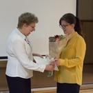 Ann giving M flowers